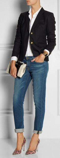 Shop this look on Lookastic:  https://lookastic.com/women/looks/blazer-dress-shirt-skinny-jeans-pumps-clutch-bracelet/13054  — White Dress Shirt  — Black Blazer  — Black and Gold Leather Bracelet  — Black and White Leather Clutch  — Blue Skinny Jeans  — Pink Leopard Leather Pumps