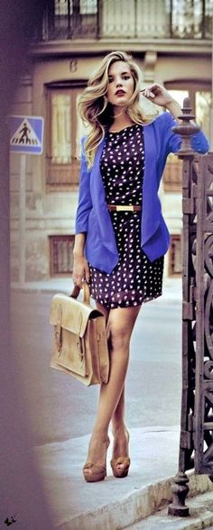 Navy blue polka dotted dress worn with a bright blue blazer and neutral accessories. Womens #style