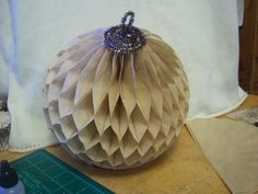 "Donna's tutorial on ""How to make her awesome honeycomb paper balls"" with dyed coffee filters and tinsel pipe cleaners!"