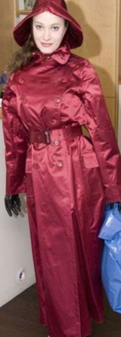 .Rubber-lined burgundy satin mac and sou'wester at a Mackintosh Society bash.