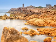 Perhaps nowhere in northwestern Brittany is quite as breathtaking as the Côte de Granit Rose (or the Pink Granite Coast), a coastline dotted with spectacular granite rock formations. The geology ranges from massive rose gold boulders to eroded pink sand, all contrasted beautifully against the gray foam of the sea.