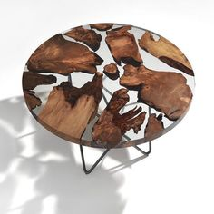 """It wants to be a stylized representation of the earth the wooden parts metaphorically representing the continents and the resin sections the oceans. The texture of wood and the transparency of the resin are capable of creating a fascinating interplay of light and shadow.""     Undiscovered designs will appear in your inbox if you click the link in bio - Deal!     for your #livingroom @riva1920"