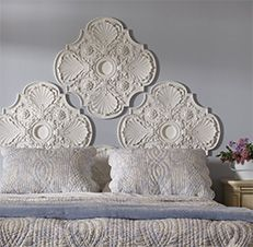 "This ""Crown Jewels"" headboard is created from ceiling medallions! It's not my personal style, but I do think it's a great idea for a DIY enthusiast."