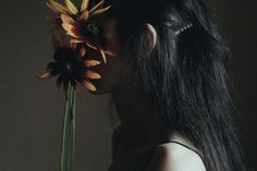 In the flowers of a black-eyed susan by Anna O. Photography