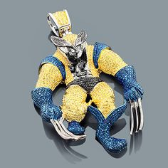 This Custom Blue and Yellow Diamond Wolverine Pendant in sterling silver weighs approximately 38 grams and showcases 2.25 carats of blue, yellow and black diamonds. Featuring an iced out 3-D design and a luxurious rhodium plating for extra shine, this unique men's diamond pendant is a great alternative to gold jewelry. Chain must be purchased separately.