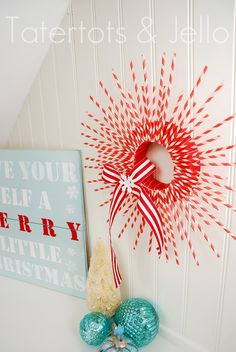Striped straw wreath.  Woman's Day has one on the cover this month and it's much nicer and fuller.  I have blue paper straws at home, but not red.  I will be on a quest to find red ones for this craft.