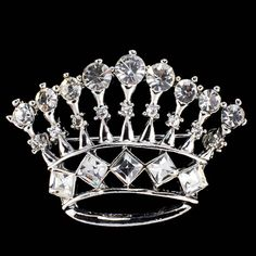 Crown+brocohes+made+of+clear+crystal+round+and+square+rhinestones.+Base+metal+plated+in+silver.+The+dimension+of+this+crown+brooch+is+measured+1-3/4+inches+wide+x+1-1/4+inches+heigh.