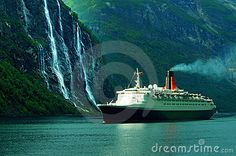 © Serban Enache | Dreamstime.com- The famous Queen Elizabeth II cruise ship sailing in the ocean, along the Seven Sisters waterfall in Norway.
