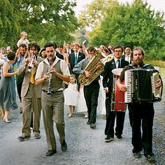 I like the idea of a band escorting the guests between the ceremony to cocktail hour
