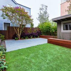 Landscape design, grass, bumps for kids to run up and down, outdoor dining, wood stained fence. Wood bench, privacy plantings.  guest house, pool house plan