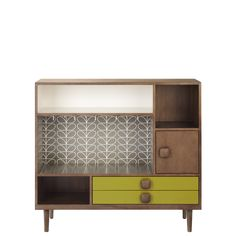 Orla Kiely: Walnut, solid and veneer mini larder. With pebble stem leaf melamine and lacquered panels. Deep storage cupboards and door glass racks with pull out worktop covered in hardwearing melamine with stem pattern. Fully assembled. For more information please contact our Mercer Street store directly.