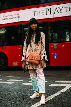 On the street at London Fashion Week Men's. #orangebag #peachbag #slipons
