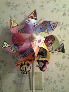 pinwheels at $1 tree.... Love this for end of year badge presentation! @Melissa Squires Squires Caton
