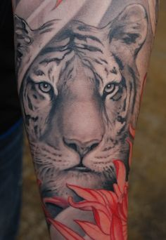 Beautifully realistic tiger tattoo with Tiger Lily, love the black and white with the flower a pop of color.