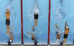 Robotic-camera shots from the Olympics - Swimmers from Australia (L), the U.S. (C) and France compete during the men's 4 x 100m freestyle relay final at the London 2012 Olympic Games at the Aquatics Centre July 29, 2012.