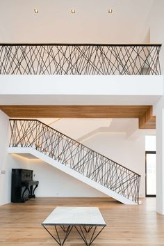 The architecture of this private house is a synthesis of natural materials — s. - The architecture of this private house is a synthesis of natural materials — stone, wood, and sim - Metal Staircase Railing, Interior Stair Railing, Modern Stair Railing, Stair Railing Design, Modern Stairs, Handrail Ideas, Pipe Railing, Stair Handrail, Glass Railing