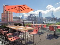 La Piscine, a pool bar and grill atop the Hotel Americano in New York City, overlooks Manhattan and the Hudson River.