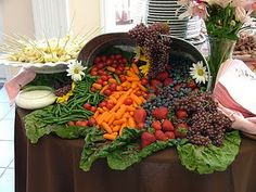 display . . . I worked at a special events company years ago and the ladies I worked for used to create veggie and fruit displays instead of trays, etc. . .it was lovely . . .
