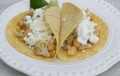 Cauliflower & Corn Tacos are a yummy vegetarian option to the traditional taco. Topped with a tangy Greek yogurt sauce- these tacos are delicous & healthy! Veg Recipes, Mexican Food Recipes, Low Carb Recipes, Ethnic Recipes, Cauliflower Stir Fry, Cauliflower Crust Pizza, Vegetarian Options, Vegetarian Recipes, Greek Yogurt Sauce