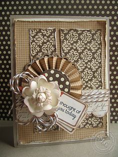 monochromatic brown card ... lots of layers and textures with flower, twine, lovely papers, rosette ... lovely!!