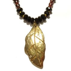 Onyx Necklace 02 Pendant Gold Leaf Black Faceted Wood Crystal Reiki Healing Beaded 19  Price : $65.00 http://www.idigcrystals.com/Necklace-Pendant-Faceted-Crystal-Healing/dp/B008QQPWQM