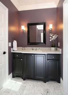 Pretty paint color, like the dark wood, light crisp counters and white trim/door with dark wood vanity, would have done  larger tiles with a little more subtle pattern on floor so eye is not drawn to the floor so much.