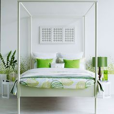 Bedroom with white walls, white floor, vivid lime cushions and lime lampshade