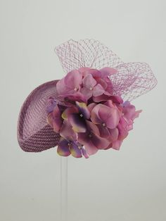 Straw percher with netting and hydrangea petals