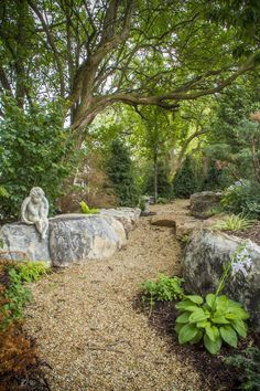 Gravel path that winds through the backyard allowing you to explore the pond and waterfalls.