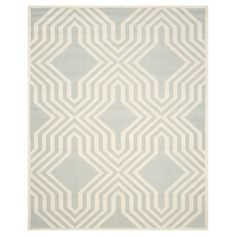 A graphic display in subtle neutrals gives the Safavieh Wellington Rug a beauty all its own. This indoor area rug is hand tufted of 100% wool and has a 100% cotton backing. The accent rug has a low pile for easy vacuuming, and the clean look is a good match for nearly any room.