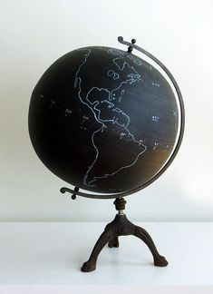 "DIY painted globe. Paint thicker white outlines than those ones. Using a gold paint marker, write on the globe the quote ""if you travel far enough, you'll meet yourself"" in big cursive letters."