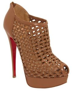 761b34827b5 See this and similar Christian Louboutin pumps - Leather platform peep toe  caged shoe bootie with studding throughout and back heelSignature red leath.