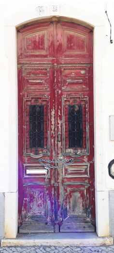 Red Wood chained  door, Lagos Portugal