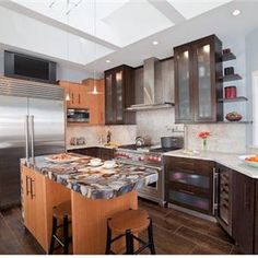 Contemporary (Modern, Retro) Kitchen, like the look of the cabinets. Would have to go with a lighter color in my house
