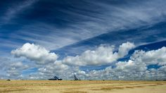 Cumulus and cirrus clouds above the Felixstowe Docks, Suffolk, July 2012.