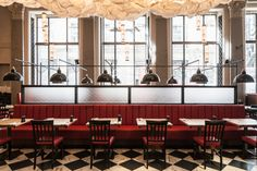 the detail of how to deal w/ hanging pendant over seats (structural support)  Burger & Lobster