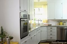 This blog has a GREAT before and after to look at. It is amazing what some handy folks can do. I love all the cabinet space. Jealous? yes.