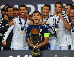 Real Madrid players (left to right) Sergio Ramos, Iker Casillas, Ronaldo and Pepe (r) celebrate with the trophy after the UEFA Super Cup match between Real Madrid and Sevilla FC at Cardiff City Stadium on August 12, 2014 in Cardiff, Wales.