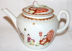 "031016: WORCESTER TEAPOT, C. 1760, H 5"", L 7 1/4"" : Lot 031016  WORCESTER TEAPOT, C. 1760, H 5"", L 7 1/4"":Porcelain teapot of globular shape with a flower finial, painted with Chinese figures. No apparent marks. Provenance: Winifred Williams Antiques, Sussex, England, August 1955."