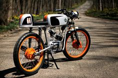 """The latest build from Tony Prust of Analog Motorcycles is this 1966 Wards Riverside—a bike that originated from an unlikely marriage between Chicago's Montgomery Ward and Benelli motorcycles of Italy. From 1959 to 1969 Montgomery Ward, the now defunct department store, sold motorcycles and scooters via a mail-order catalogue. Under the brand name of """"Wards…"""