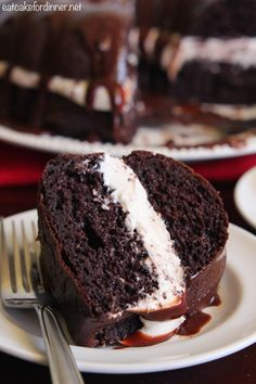 Chocolate Whoopie Pie Cake is a delicious spin on the classic whoopie pie!  A dense chocolate cake filled with a soft and pillowy marshmallow filling and drizzled in a chocolate ganache.