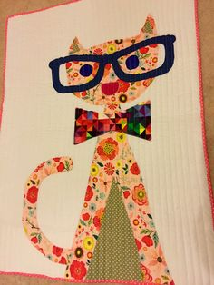A personal favorite from my Etsy shop https://www.etsy.com/uk/listing/246131351/hipster-cat-baby-quilt-appliquecribmoses