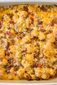 Taco Tater Tot Casserole - taco meat, diced tomatoes and green chiles, cheese, cheese soup, sour cream and tater tots - what's not to love? We ate this twice in one day! Can be made ahead of time and refrigerated or frozen for later. You can also divide it between two 8x8-inch foil pans and freeze one.  Taco night will never be the same! Tator Tot Taco Casserole, Cowboy Casserole, Beef Casserole, Potatoe Casserole Recipes, Potato Nachos, Tater Tot Recipes, Ground Beef Recipes, Mexican Food Recipes, Ethnic Recipes