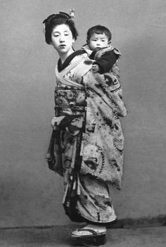 Girl carrying a baby. Late 19th century, Japan by M. Nakajima of Tokyo. [image is de-colored from the original posted by Formosasavage of Flickr)