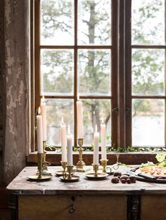 Traditional Swedish brass candleholders in a beautiful, rustic mill on the shores of lake Rinnen. Photo Carina Olander. Styling Anna Truelsen.