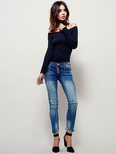 Super Duper Skinny | Premium distressed low-rise denim skinnies with bronze hardware, a button-fly, four-pocket design, and cropped, frayed hems.