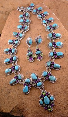 Natural Red Mtn., NV Turquoise with Amethyst and Peridot necklace and earrings.  Necklace: $2900.00, Earrings: $240.00