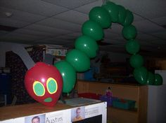 Hungry Caterpillar made out of baloons over the entrance to the preschool room.