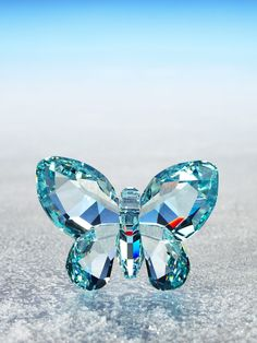 LIGHT AZORE crystal BUTTERFLY figurine by Swarovski Figurines