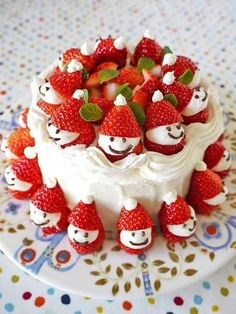 Cake with strawberry Santas!